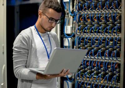 Young Engineer Managing Supercomputer Servers